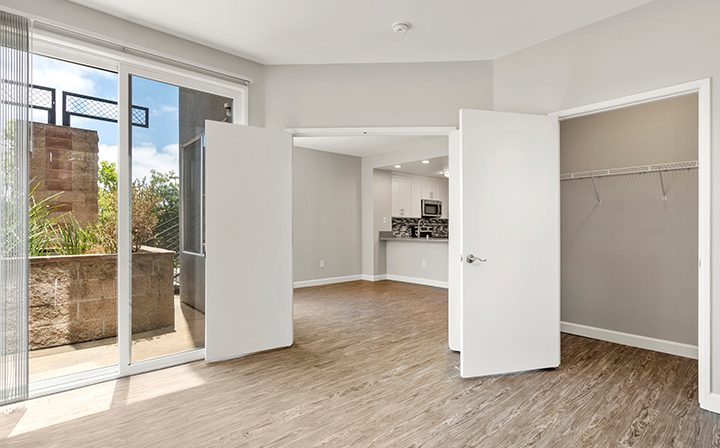 Bedroom with patio exit in the 1x1 Bay Bridge floor plan at the Bridge at Emeryville apartments