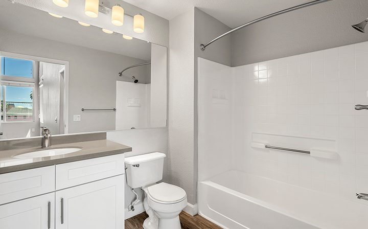 Brightly lit bathroom in the 2x2 Marina Loft floor plan at the Bridge at Emeryville apartments
