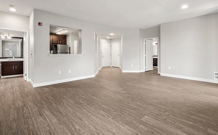 Living room and kitchen in the 2x2 Marina floor plan at the Bridge at Emeryville apartments