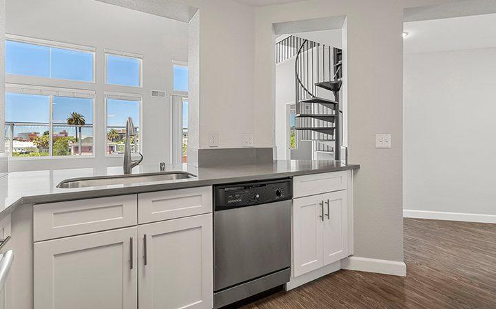 Sunny kitchen in the 2x2 Marina Loft floor plan at the Bridge at Emeryville apartments