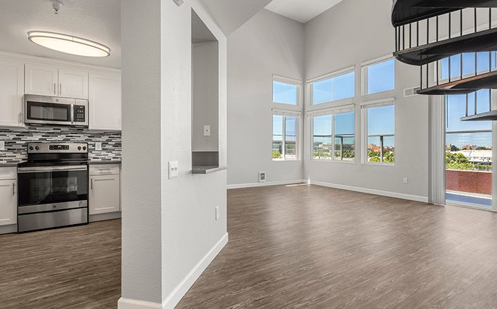 Living room and kitchen in the 2x2 Marina Loft floor plan at the Bridge at Emeryville apartments