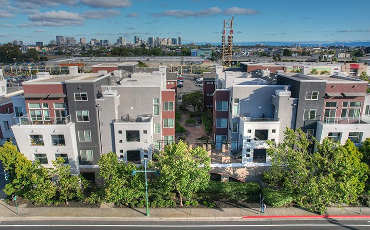 Daytime aerial streetside view of the Bridge at Emeryville apartments community