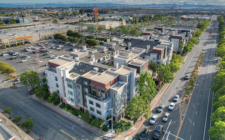 Arial view of the Bay Area skyline and the Bridge at Emeryville apartments community