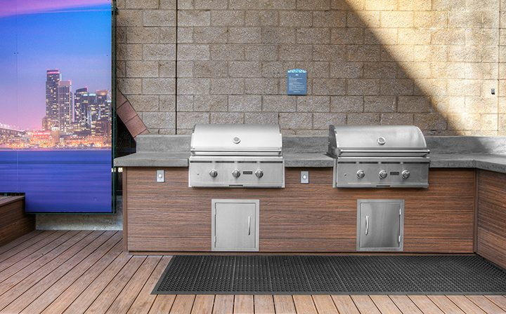 Two BBQ grills at the Bridge at Emeryville apartments community, near the pool area