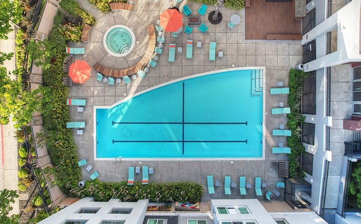 Aerial view of resort-style pool area at the Bridge at Emeryville apartments community