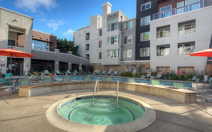 Circular hot tub below units at the Bridge at Emeryville apartments community pool area