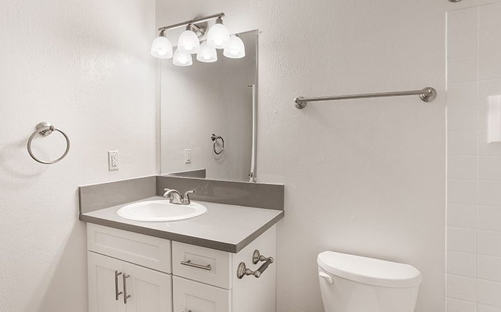 Unfurnished bathroom with vanity lights over mirror at The Bridge at Walnut Creek apartments