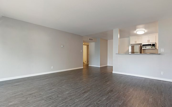 Unfurnished livingroom and kitchen with ample natural light at The Bridge at Walnut Creek apartments