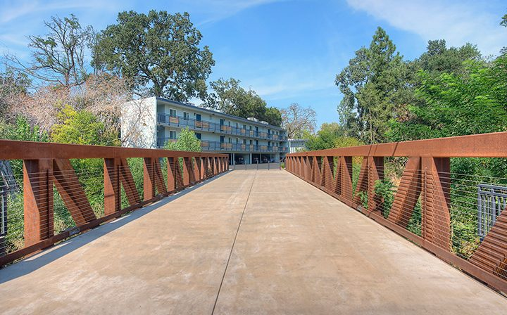 Eponymous bridge walkway leading to The Bridge at Walnut Creek apartments