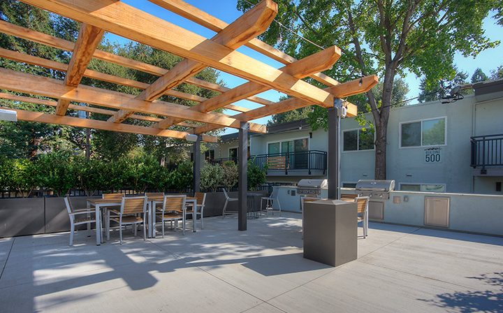 BBQ area with grills and seating under area at The Bridge at Walnut Creek apartments