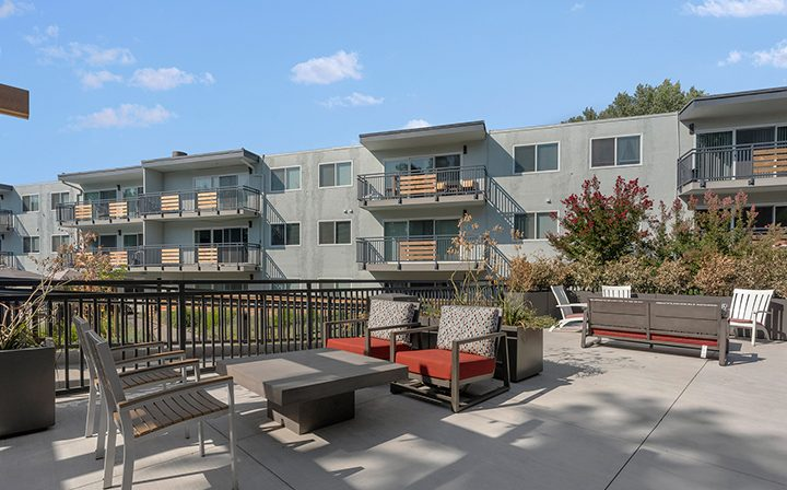 Firepit area with lounge seating outside at The Bridge at Walnut Creek apartments
