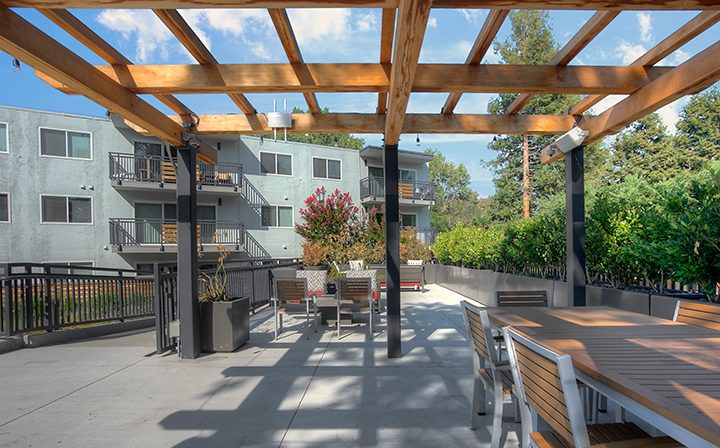 Seating near BBQ area with grills at The Bridge at Walnut Creek apartments
