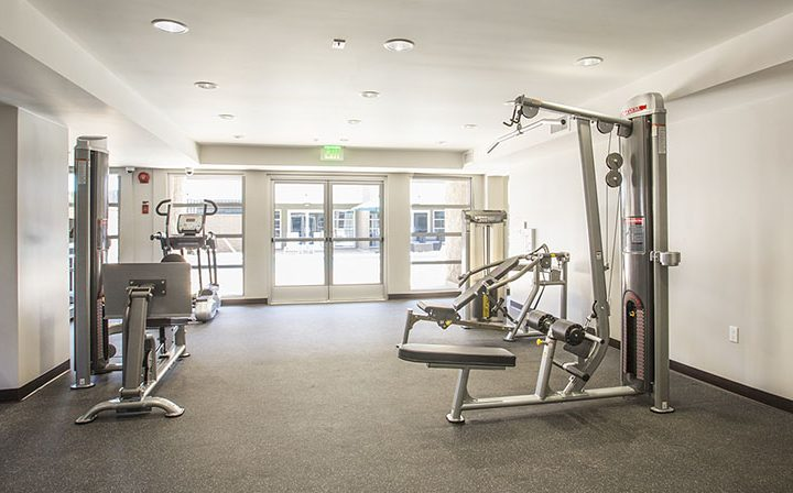 State-of-the-art fitness center with machines at The Howard, apartments in Glendale