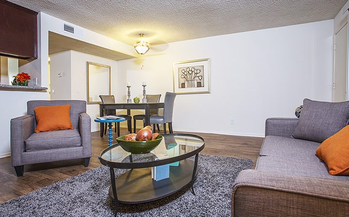 Cushioned seating and rug in the clubhouse at The Howard, apartments in Glendale