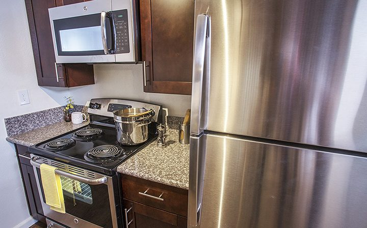 Furnished kitchen with microwave over range at The Howard, apartments in Glendale