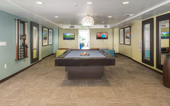 Billiards table in the clubhouse at the Glendale apartments community The Howard