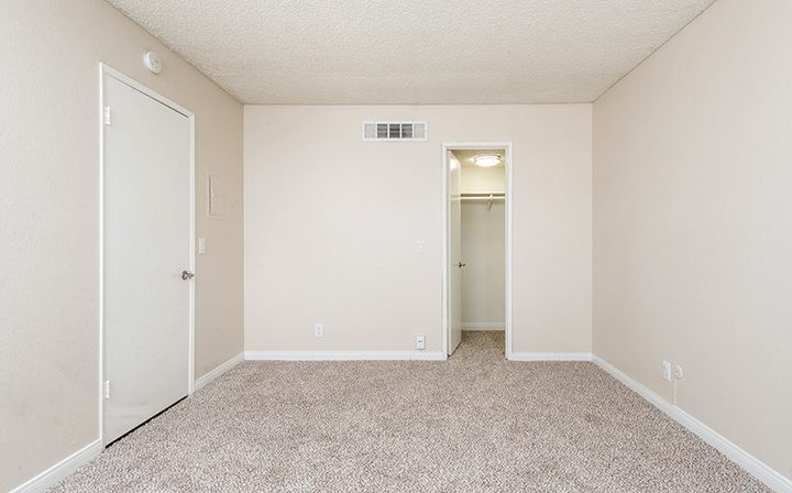 Unfurnished bedroom with walk-in closet at the Glendale apartments community The Howard