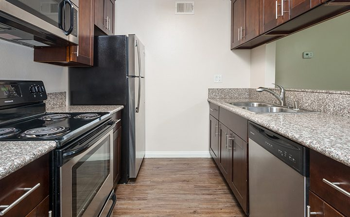 Unfurnished kitchen with range opposite sink at the Glendale apartments community The Howard