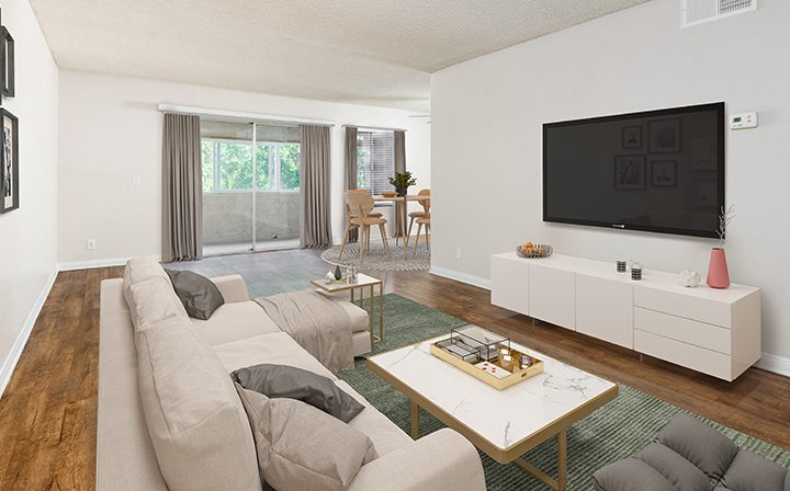 Furnished living room with wood flooring in a model unit at The Howard, apartments in Glendale