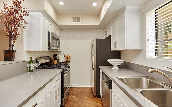 Furnished kitchen with range opposite sink at the West Los Angeles apartments community The Jeremy