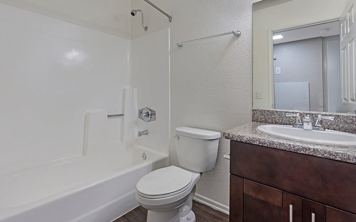 Unfurnished bathroom with brown cabinets at the West Los Angeles apartments community The Jeremy