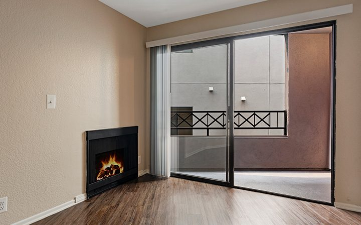 Fireplace next to balcony exit at the West Los Angeles apartments community The Jeremy