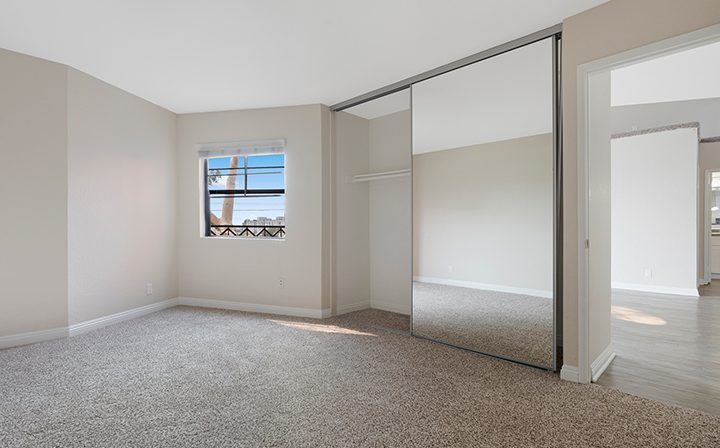 Unfurnished bedroom with mirrored closet at the West Los Angeles apartments community The Jeremy
