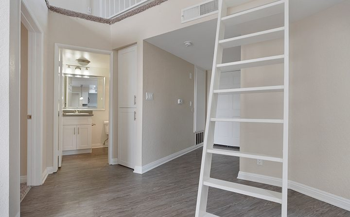 Unfurnished hallway with stairs to loft at the West Los Angeles apartments community The Jeremy