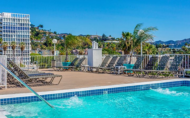 Pool on rooftop of The Jessica, apartments in Hollywood with a rooftop spa and more