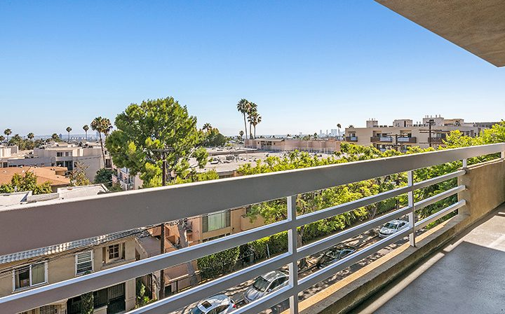 Beautiful, sunny balcony view of the city from the Hollywood apartments community The Jessica