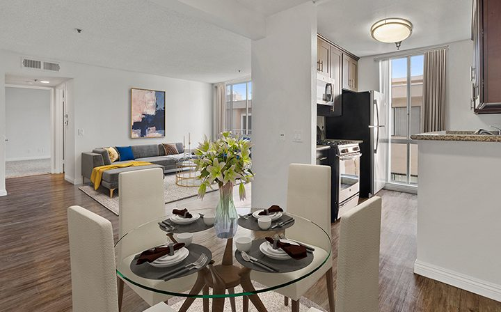Furnished dining room in a model unit at the Hollywood apartments community The Jessica