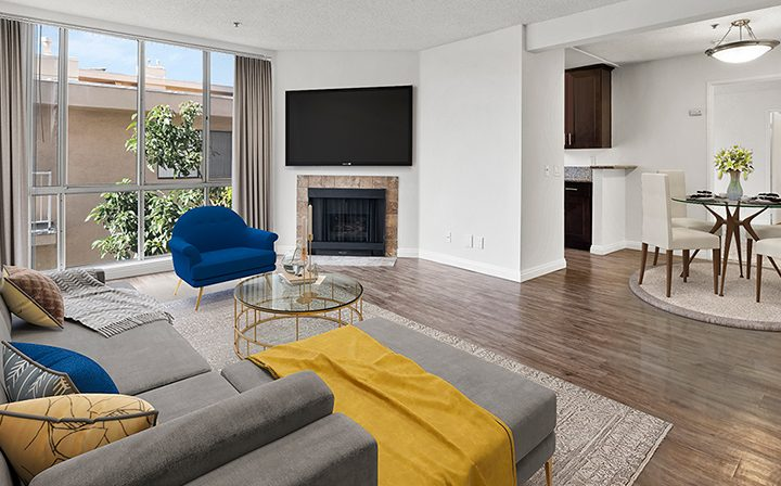 Furnished living room in a model unit at the Hollywood apartments community The Jessica