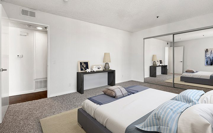 Furnished bedroom in a model unit at the Hollywood apartments community The Jessica