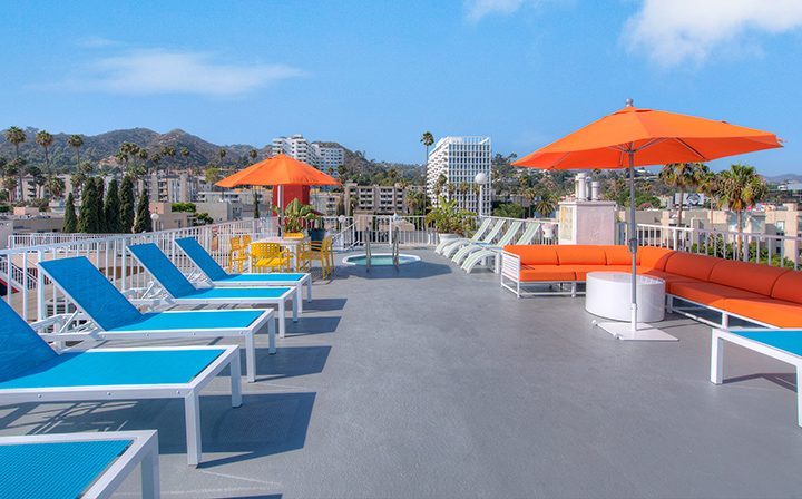 Lounge chairs on the rooftop of The Jessica, apartments in Hollywood with a rooftop spa and more