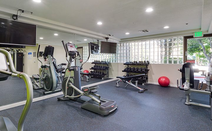 Exercise machines and equipment at on-site fitness center for The Joshua, apartments in Hollywood