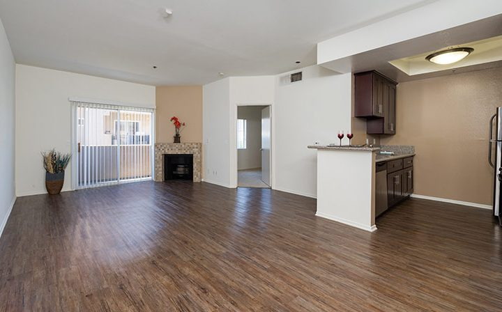Unfurnished living room with fireplace at the Hollywood apartments community The Joshua