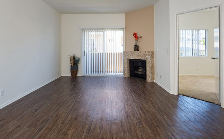 Balcony exit and fireplace in living room at the Hollywood apartments community The Joshua