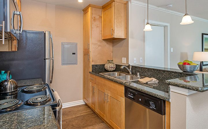 Furnished kitchen with light brown cabinets at The Palms, apartments in West Los Angeles