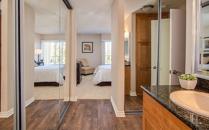Mirrored closet doors between bathroom and bedroom at The Palms, apartments in West Los Angeles