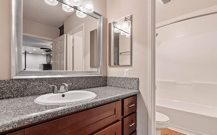 Unfurnished bathroom vanity with brown cabinets at The Palms, apartments in West Los Angeles