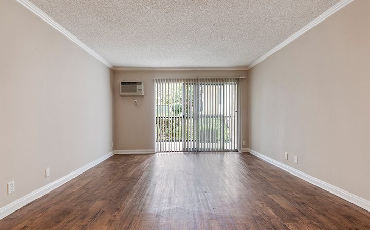 Unfurnished living room facing balcony exit at The Palms, West Los Angeles apartments