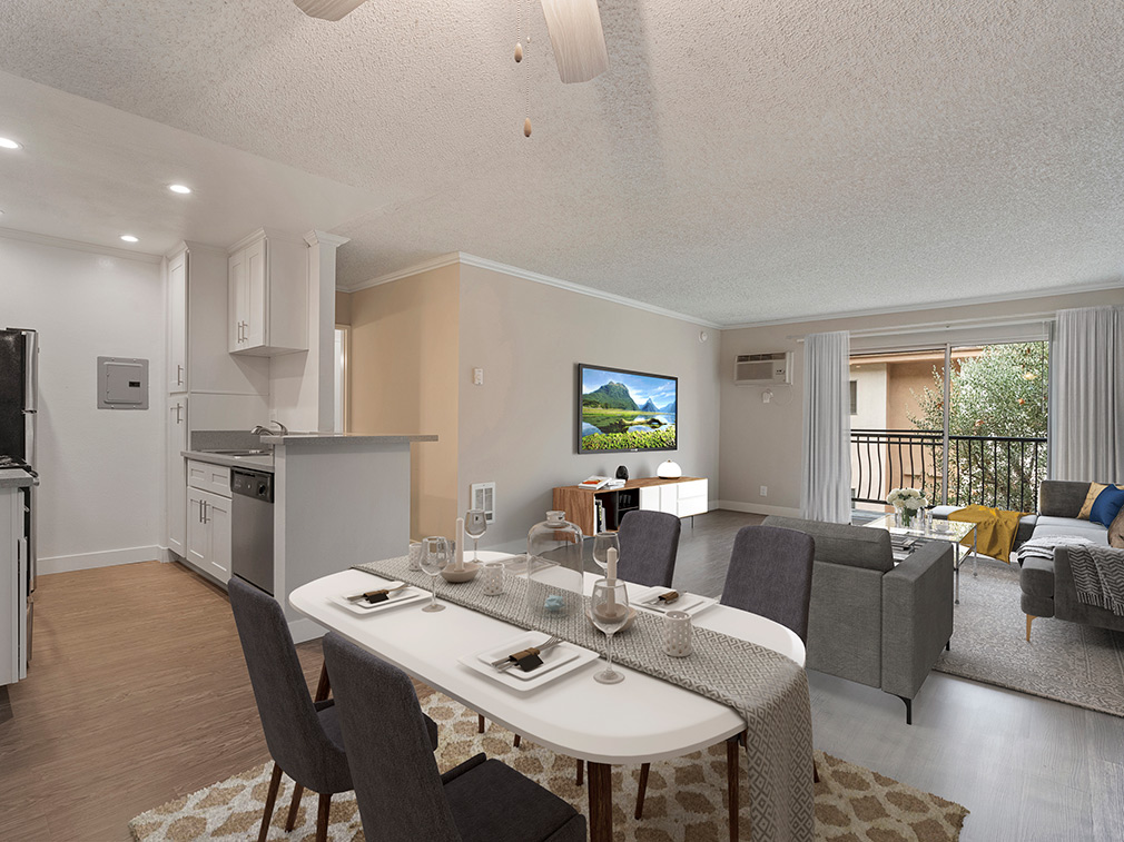 Furnished dining room with wood floors in model unit at The Palms, West Los Angeles apartments