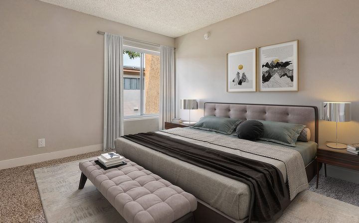 Furnished bedroom with ample natural light in model unit at The Palms, West Los Angeles apartments