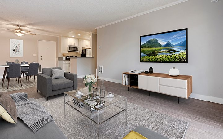 Furnished living room with wood floors in model unit at The Palms, West Los Angeles apartments
