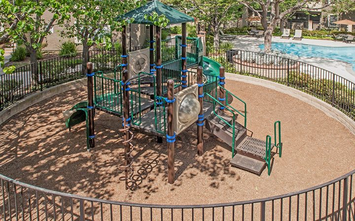 Outdoor enclosed children's playground structure at The Ranch at Moorpark, apartments in Moorpark