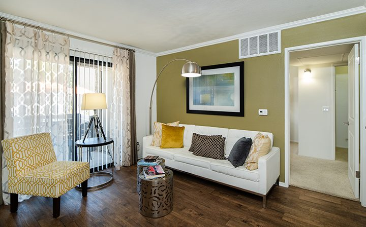 Furnished living room with dark wood floor at The Ranch at Moorpark, apartments in Moorpark
