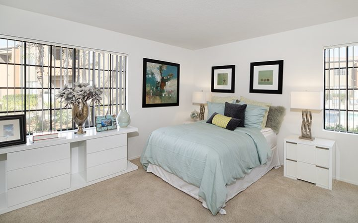 Bedroom with furnishing, carpet, and large windows at The Ranch at Moorpark, Moorpark apartments