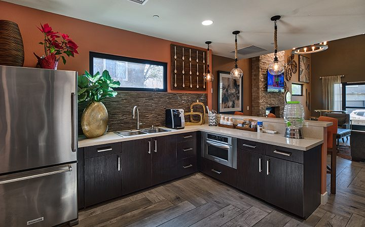 Furnished kitchen dark brown cabinets and floor at The Ranch at Moorpark, Moorpark apartments