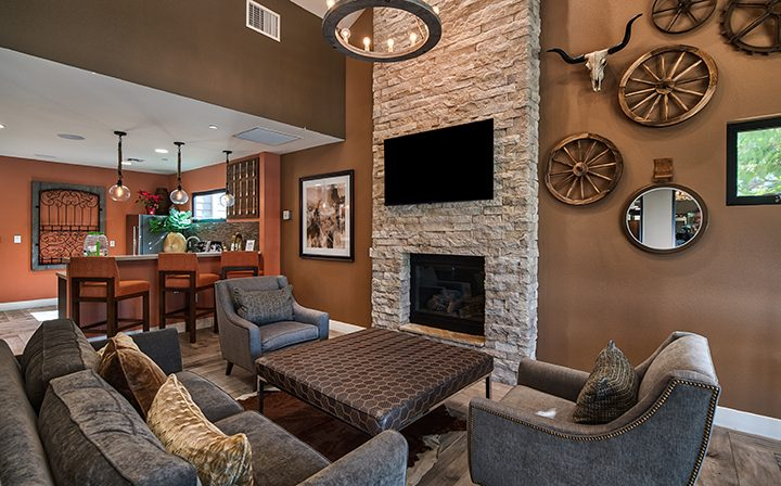 Seating by fireplace and TV in community clubhouse at The Ranch at Moorpark, Moorpark apartments