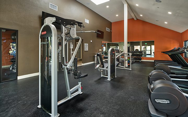 Fitness center with machines and arched ceiling at The Ranch at Moorpark, Moorpark apartments
